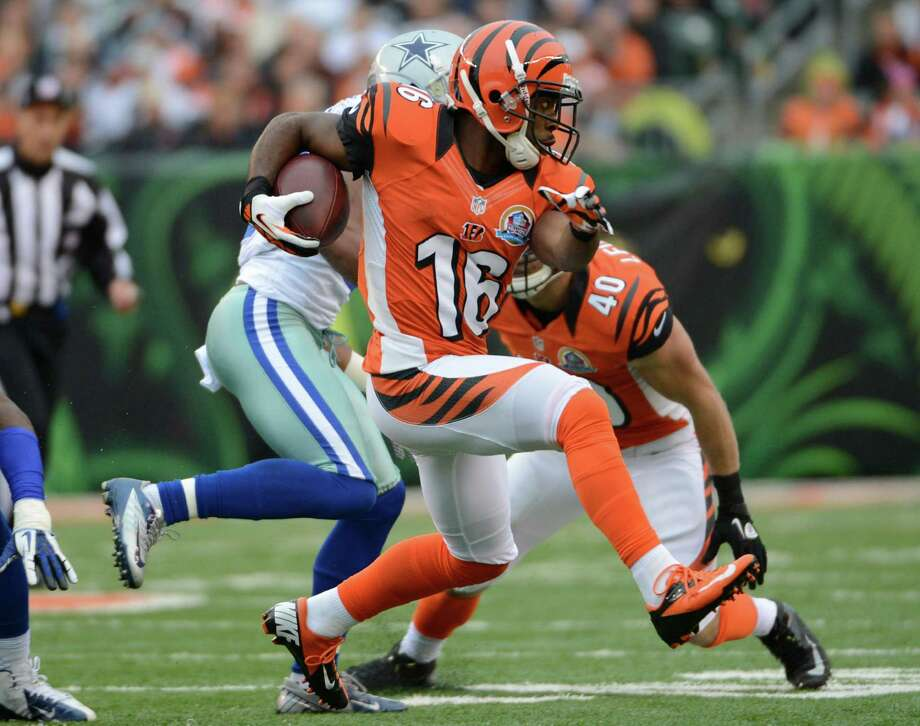 Cincinnati Bengals wide receiver Andrew Hawkins (16) runs against the Dallas Cowboys in the second half of an NFL football game, Sunday, Dec. 9, 2012, in Cincinnati. (AP Photo/Michael Keating) Photo: Michael Keating, Associated Press / FR170759 AP