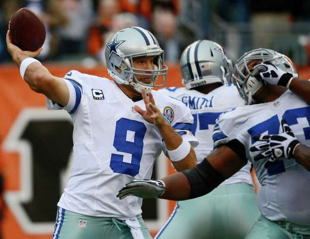 Dallas Cowboys quarterback Tony Romo (9) passes against the Cincinnati Bengals in the first half of an NFL football game, Sunday, Dec. 9, 2012, in Cincinnati. (AP Photo/Michael Keating) Photo: Michael Keating, Associated Press / FR170759 AP