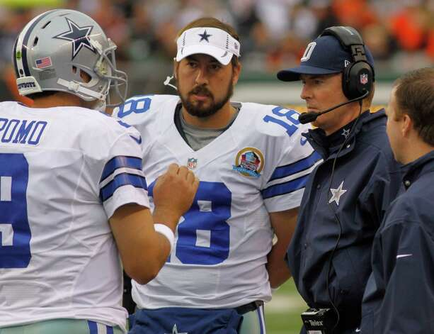 Dallas Cowboys head coach Jason Garrett, right, talks with quarterback Tony Romo (9) and quarterback Kyle Orton (18) in the second half of an NFL football game against the Cincinnati Bengals, Sunday, Dec. 9, 2012, in Cincinnati. (AP Photo/Tom Uhlman) Photo: Tom Uhlman, Associated Press / FR31154 AP
