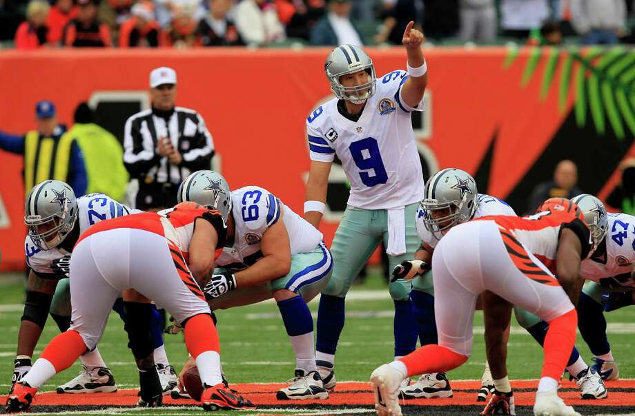 Dallas Cowboys quarterback Tony Romo (9) calls a play in the first half of an NFL football game against the Cincinnati Bengals, Sunday, Dec. 9, 2012, in Cincinnati. (AP Photo/Al Behrman) Photo: Al Behrman, Associated Press / AP