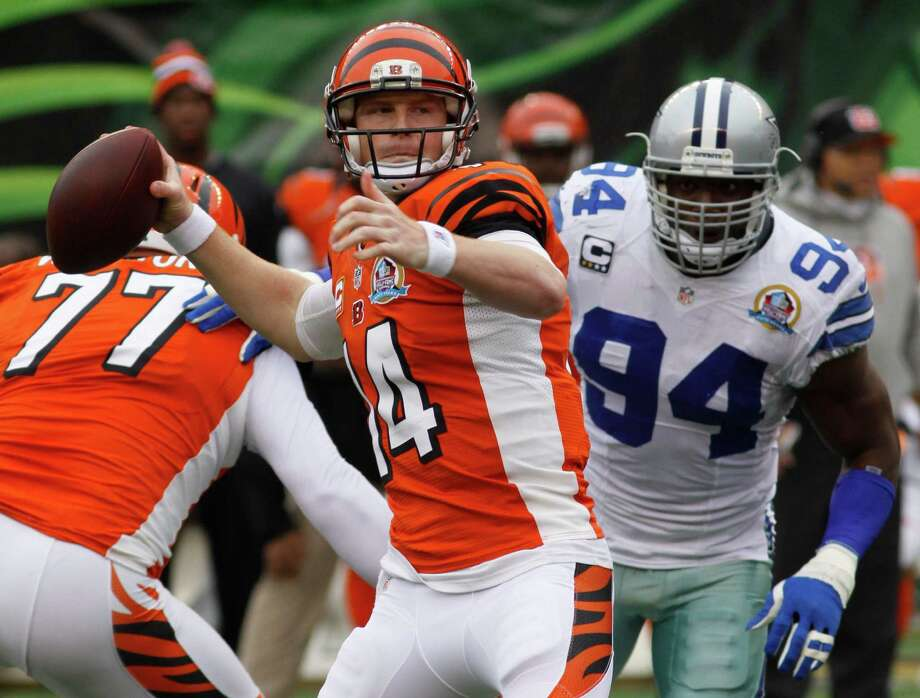 Cincinnati Bengals quarterback Andy Dalton (14) passes against the Dallas Cowboys in the second half of an NFL football game, Sunday, Dec. 9, 2012, in Cincinnati. (AP Photo/Tom Uhlman) Photo: Tom Uhlman, Associated Press / FR31154 AP