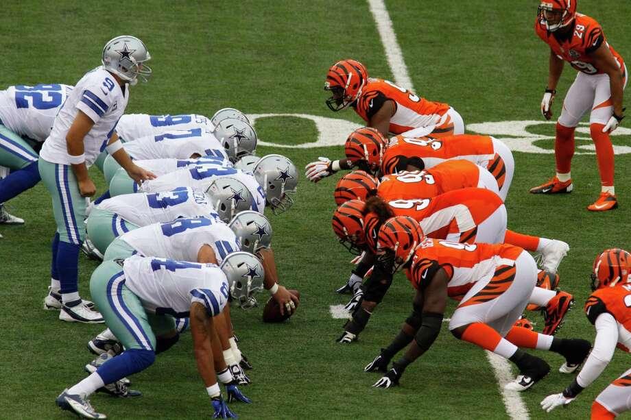 Dallas Cowboys players line up against Cincinnati Bengals players in the first half of an NFL football game, Sunday, Dec. 9, 2012, in Cincinnati. (AP Photo/Tom Uhlman) Photo: Tom Uhlman, Associated Press / FR31154 AP
