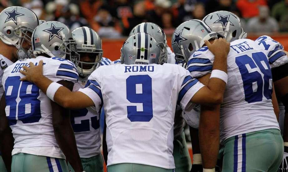 Dallas Cowboys quarterback Tony Romo (9) calls a play in the second half of an NFL football game against the Cincinnati Bengals, Sunday, Dec. 9, 2012, in Cincinnati. (AP Photo/Tom Uhlman) Photo: Tom Uhlman, Associated Press / FR31154 AP