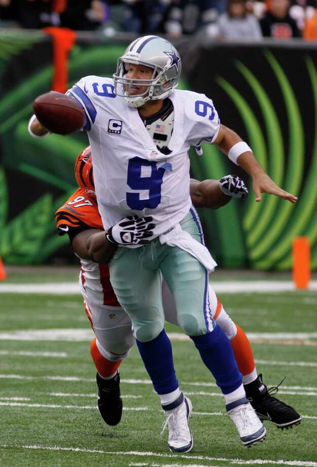 Dallas Cowboys quarterback Tony Romo (9) is sacked by Cincinnati Bengals defensive tackle Geno Atkins (97) in the second half of an NFL football game, Sunday, Dec. 9, 2012, in Cincinnati. (AP Photo/Tom Uhlman) Photo: Tom Uhlman, Associated Press / FR31154 AP