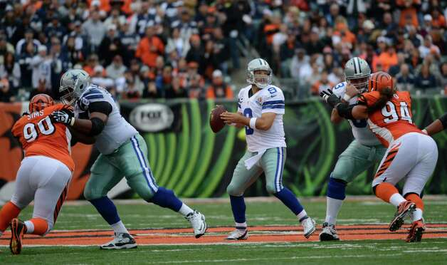 Dallas Cowboys quarterback Tony Romo (9) passes against the Dallas Cowboys in the first half of an NFL football game, Sunday, Dec. 9, 2012, in Cincinnati. (AP Photo/Michael Keating) Photo: Michael Keating, Associated Press / FR170759 AP