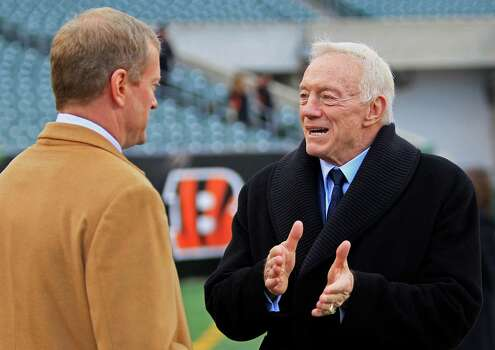 Dallas Cowboys owner Jerry Jones, right, talks with Jerry Jones Jr. prior to an NFL football game against theCincinnati Bengals, Sunday, Dec. 9, 2012, in Cincinnati. (AP Photo/Al Behrman) Photo: Al Behrman, Associated Press / AP