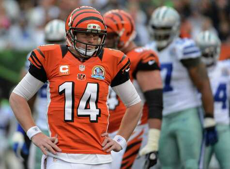 Cincinnati Bengals quarterback Andy Dalton (14) waits on the field in the second half of an NFL football game against the Dallas Cowboys, Sunday, Dec. 9, 2012, in Cincinnati. (AP Photo/Michael Keating) Photo: Michael Keating, Associated Press / FR170759 AP