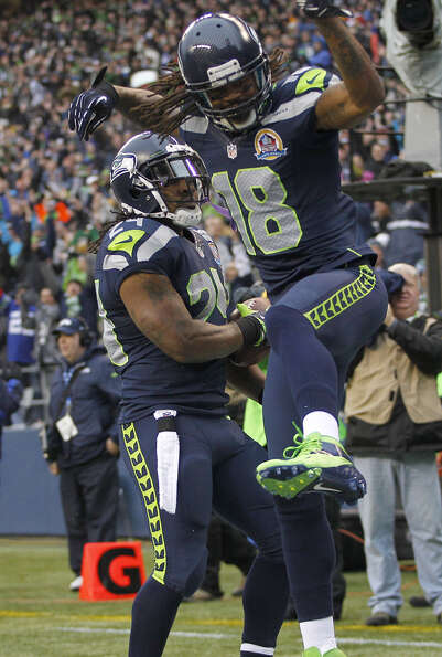 Seattle Seahawks running back Marshawn Lynch (24) celebrates with wide receiver Sidney Rice (18) aft