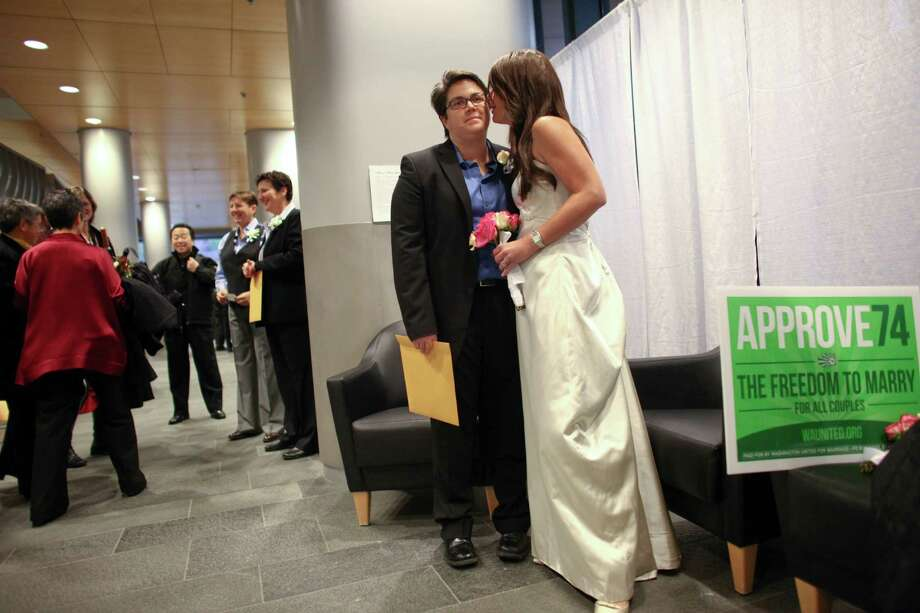 Carrie Carson waits in a staging area with her wife Lori Robb, right in Seattle City Hall during marriage ceremonies. Photo: JOSHUA TRUJILLO / SEATTLEPI.COM