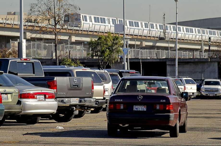Parking spots are scarce at the West Oakland station despite a $5 charge. Fees are lower or nonexistent at other BART stations. Photo: Michael Macor, The Chronicle
