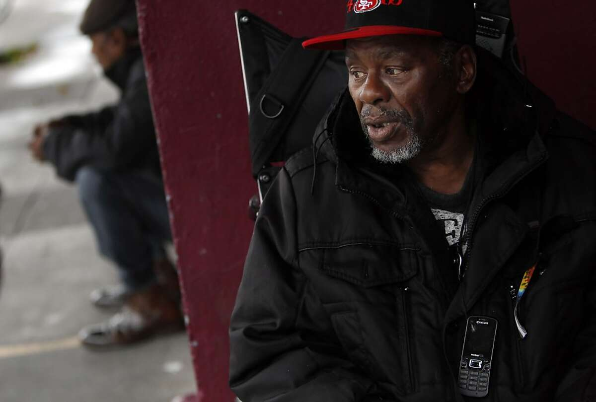"""William Locke, who is in a wheelchair, wears his cell phone around his neck and says he could really use the money he would save with low-cost/free cell phone plan as he is homeless and living at the Multi-Services Center in San Francisco, Calif., on Thursday, November 29, 2012. Bevan Dufty is trying to get free/low-cost cell phones for the homeless in San Francisco so they can keep better connected to services and support systems like family and friends. The program, much like the lifeline"""" rates for seniors, is facing some legal problems, and Dufty is pushing everyone from the PUC on down to make the program happen."""