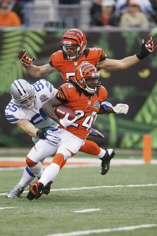 Adam Jones #24 of the Cincinnati Bengals runs the ball upfield against Alex Albright #55 of the Dallas Cowboys during their game at Paul Brown Stadium on December 9, 2012 in Cincinnati, Ohio.  The Cowboys defeated the Bengals 20-19. Photo: John Grieshop, Getty Images / 2012 Getty Images