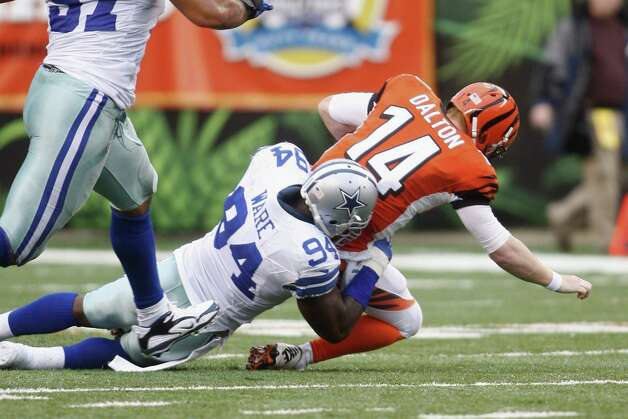 DeMarcus Ware #94 of the Dallas Cowboys sacks Andy Dalton #14 of the Cincinnati Bengals during their game at Paul Brown Stadium on December 9, 2012 in Cincinnati, Ohio.  The Cowboys defeated the Bengals 20-19. Photo: John Grieshop, Getty Images / 2012 Getty Images