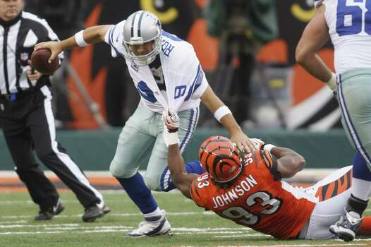 Michael Johnson #93 of the Cincinnati Bengals sacks Tony Romo #9 of the Dallas Cowboys during their game at Paul Brown Stadium on December 9, 2012 in Cincinnati, Ohio.  The Cowboys defeated the Bengals 20-19. Photo: John Grieshop, Getty Images / 2012 Getty Images