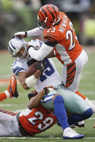 Terence Newman #23 of the Cincinnati Bengals tackles Miles Austin #19 of the Dallas Cowboys during their game at Paul Brown Stadium on December 9, 2012 in Cincinnati, Ohio.  The Cowboys defeated the Bengals 20-19. Photo: John Grieshop, Getty Images / 2012 Getty Images