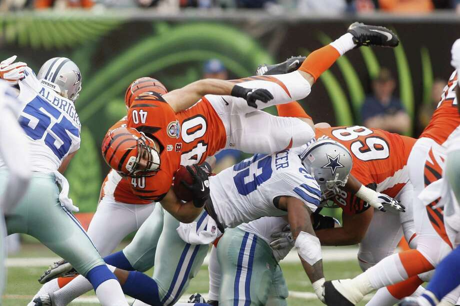 Brian Leonard #40 of the Cincinnati Bengals runs over Anthony Spencer #93 of the Dallas Cowboys during their game at Paul Brown Stadium on December 9, 2012 in Cincinnati, Ohio.  The Cowboys defeated the Bengals 20-19. Photo: John Grieshop, Getty Images / 2012 Getty Images