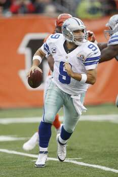 Tony Romo #9 of the Dallas Cowboys rolls out under pressure during the game against the Cincinnati Bengals at Paul Brown Stadium on December 9, 2012 in Cincinnati, Ohio.  The Cowboys defeated the Bengals 20-19. Photo: John Grieshop, Getty Images / 2012 Getty Images