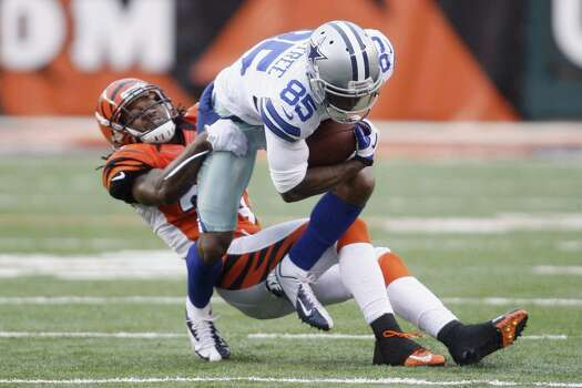 Kevin Ogletree #85 of the Dallas Cowboys runs the ball upfield against Adam Jones #24 of the Cincinnati Bengals during their game at Paul Brown Stadium on December 9, 2012 in Cincinnati, Ohio.  The Cowboys defeated the Bengals 20-19. Photo: John Grieshop, Getty Images / 2012 Getty Images