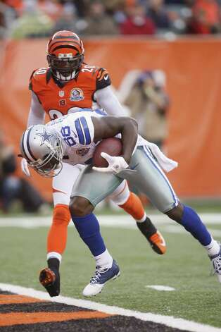 Dez Bryant #88 of the Dallas Cowboys crosses the goal line in front of Reggie Nelson #20 of the Cincinnati Bengals during their game at Paul Brown Stadium on December 9, 2012 in Cincinnati, Ohio.  The Cowboys defeated the Bengals 20-19. Photo: John Grieshop, Getty Images / 2012 Getty Images