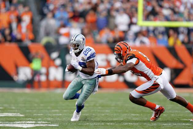 DeMarco Murray #29 of the Dallas Cowboys rushes for a first down on the game-winning drive in the fourth quarter against the Cincinnati Bengals during the game at Paul Brown Stadium on December 9, 2012 in Cincinnati, Ohio. Dallas won 20-19. Photo: Joe Robbins, Getty Images / 2012 Getty Images
