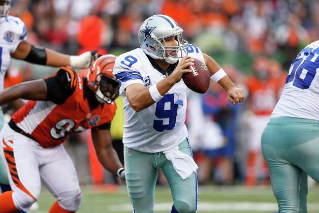 Tony Romo #9 of the Dallas Cowboys looks to pass the ball while under pressure against the Cincinnati Bengals at Paul Brown Stadium on December 9, 2012 in Cincinnati, Ohio. Dallas won 20-19. Photo: Joe Robbins, Getty Images / 2012 Getty Images