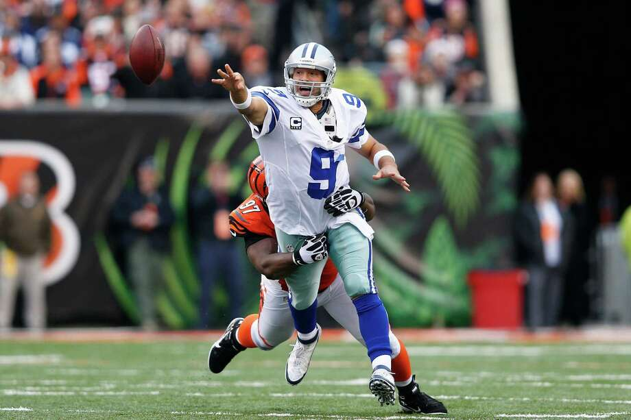 Tony Romo #9 of the Dallas Cowboys tosses the ball away while under pressure from Geno Atkins #97 of the Cincinnati Bengals during the game at Paul Brown Stadium on December 9, 2012 in Cincinnati, Ohio. Dallas won 20-19. Photo: Joe Robbins, Getty Images / 2012 Getty Images