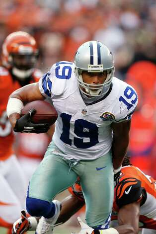 Miles Austin #19 of the Dallas Cowboys runs after a reception against the Cincinnati Bengals during the game at Paul Brown Stadium on December 9, 2012 in Cincinnati, Ohio. Dallas won 20-19. Photo: Joe Robbins, Getty Images / 2012 Getty Images