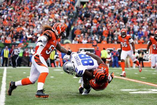 Adam Jones #24 and Rey Maualuga #58 of the Cincinnati Bengals make a tackle against Dez Bryant #88 of the Dallas Cowboys during the game at Paul Brown Stadium on December 9, 2012 in Cincinnati, Ohio. Dallas won 20-19. Photo: Joe Robbins, Getty Images / 2012 Getty Images