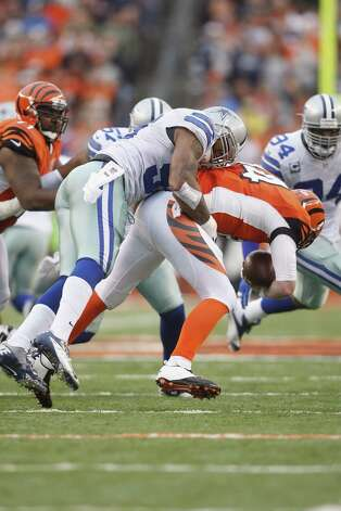 Anthony Spencer #93 of the Dallas Cowboys sacks Andy Dalton #14 of the Cincinnati Bengals during their game at Paul Brown Stadium on December 9, 2012 in Cincinnati, Ohio.  The Cowboys defeated the Bengals 20-19. Photo: John Grieshop, Getty Images / 2012 Getty Images
