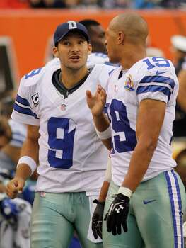 Dallas Cowboys quarterback Tony Romo (9) talks with wide receiver Miles Austin (19) in the second half of an NFL football game against the Cincinnati Bengals, Sunday, Dec. 9, 2012, in Cincinnati. (AP Photo/Tom Uhlman) Photo: Tom Uhlman, Associated Press / FR31154 AP