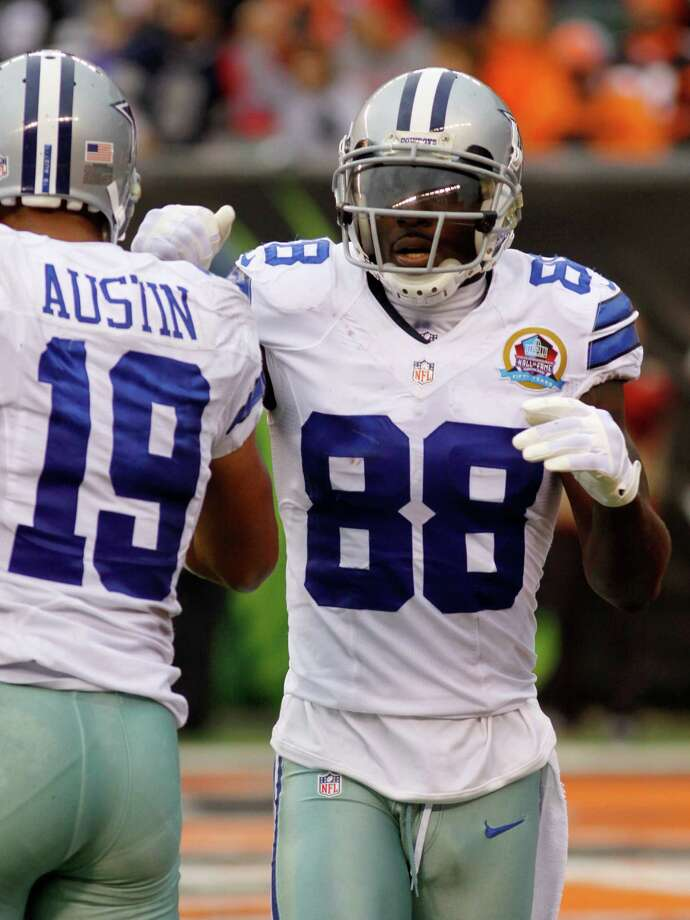 Dallas Cowboys wide receiver Dez Bryant (88) is congratulated by wide receiver Miles Austin (19) after Bryant scored on a 27-yard pass reception in the second half of an NFL football game against the Cincinnati Bengals, Sunday, Dec. 9, 2012, in Cincinnati. Dallas won 20-19. (AP Photo/Tom Uhlman) Photo: Tom Uhlman, Associated Press / FR31154 AP