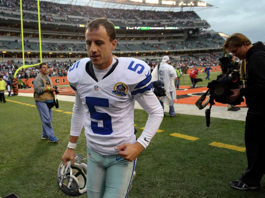 Dallas Cowboys kicker Dan Bailey (5) leaves the field after the Cowboys defeated the Cincinnati Bengals 20-19 in an NFL football game, Sunday, Dec. 9, 2012, in Cincinnati. (AP Photo/Michael Keating) Photo: Michael Keating, Associated Press / FR170759 AP