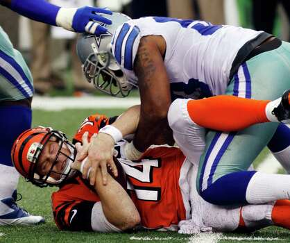 Cincinnati Bengals quarterback Andy Dalton (14) is sacked by Dallas Cowboys outside linebacker Anthony Spencer in the second half of an NFL football game, Sunday, Dec. 9, 2012, in Cincinnati. Dallas won 20-19. (AP Photo/Tom Uhlman) Photo: Tom Uhlman, Associated Press / FR31154 AP