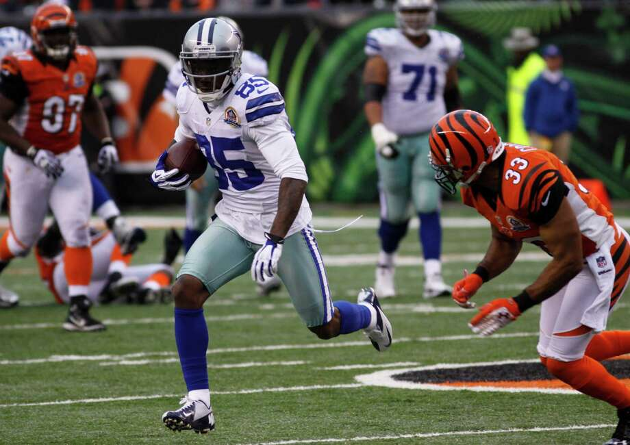 Dallas Cowboys wide receiver Kevin Ogletree (85) runs against the Cincinnati Bengals' Chris Crocker in the second half of an NFL football game, Sunday, Dec. 9, 2012, in Cincinnati. (AP Photo/Tom Uhlman) Photo: Tom Uhlman, Associated Press / FR31154 AP
