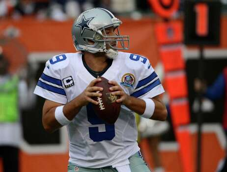 Dallas Cowboys quarterback Tony Romo looks to pass against the Cincinnati Bengals in the first half of an NFL football game, Sunday, Dec. 9, 2012, in Cincinnati. (AP Photo/Michael Keating) Photo: Michael Keating, Associated Press / FR170759 AP