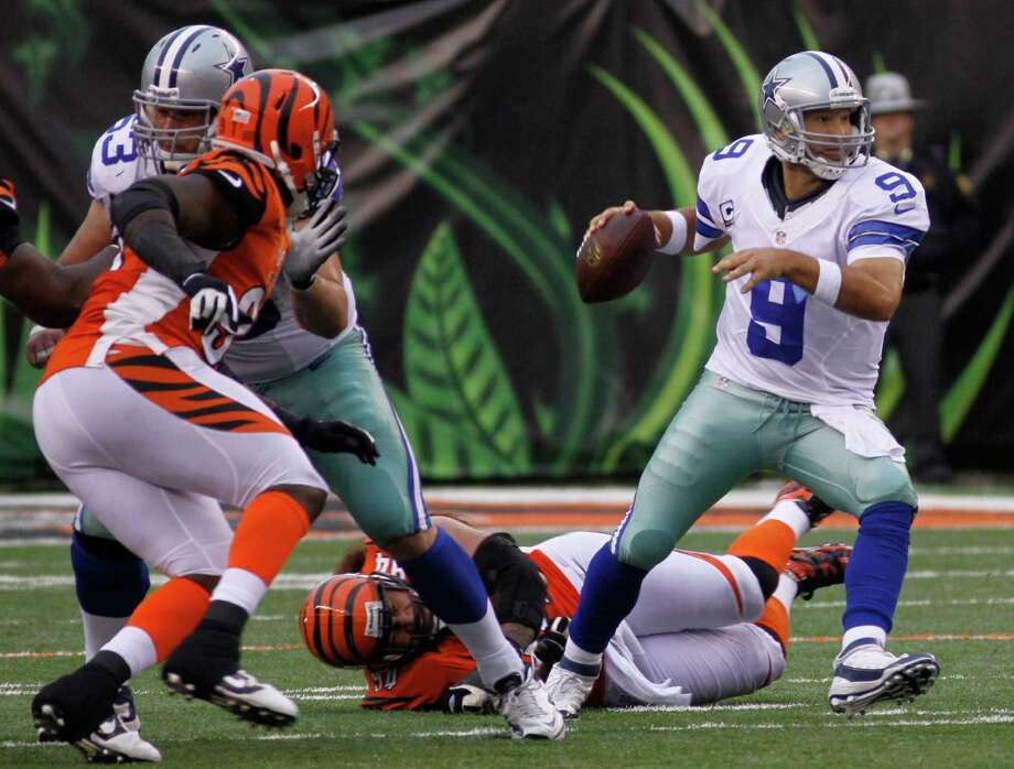 Dallas Cowboys quarterback Tony Romo (9) looks to pass against the Cincinnati Bengals in the second half of an NFL football game, Sunday, Dec. 9, 2012, in Cincinnati. (AP Photo/Tom Uhlman) Photo: Tom Uhlman, Associated Press / FR31154 AP