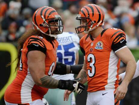 Cincinnati Bengals kicker Josh Brown (3) is congratulated by Domata Peko after Brown kicked a field goal against the Dallas Cowboys in the second half of an NFL football game, Sunday, Dec. 9, 2012, in Cincinnati. Brown kicked four field goals in the game won by Dallas 20-19. (AP Photo/Michael Keating) Photo: Michael Keating, Associated Press / FR170759 AP