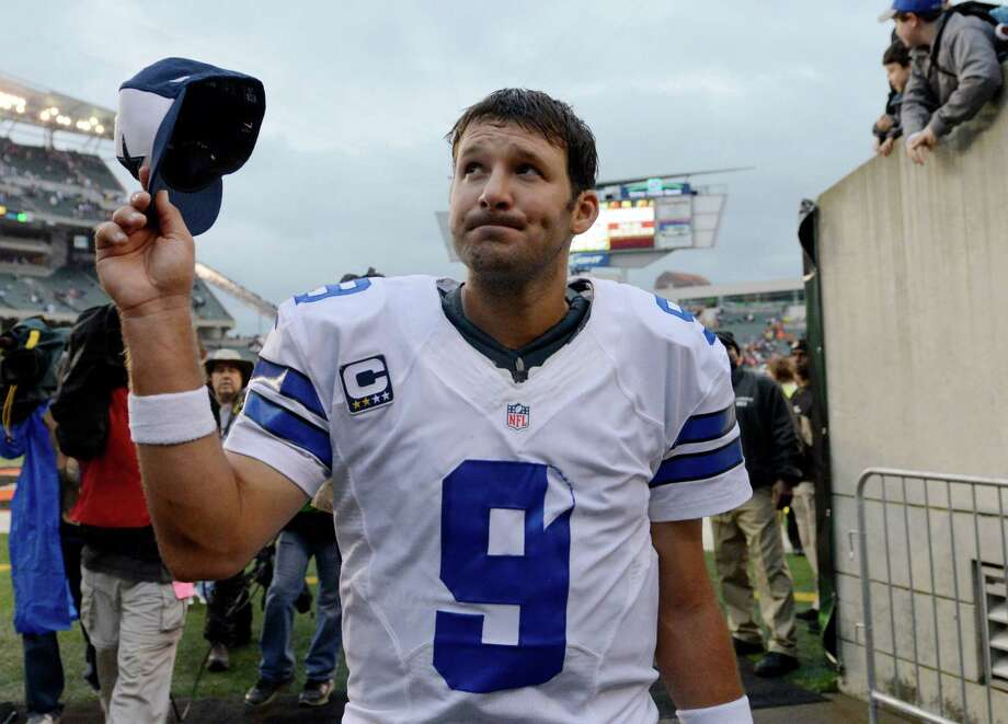Dallas Cowboys quarterback Tony Romo leaves the field after the Cowboys defeated the Cincinnati Bengals 20-19 in an NFL football game, Sunday, Dec. 9, 2012, in Cincinnati. (AP Photo/Michael Keating) Photo: Michael Keating, Associated Press / FR170759 AP