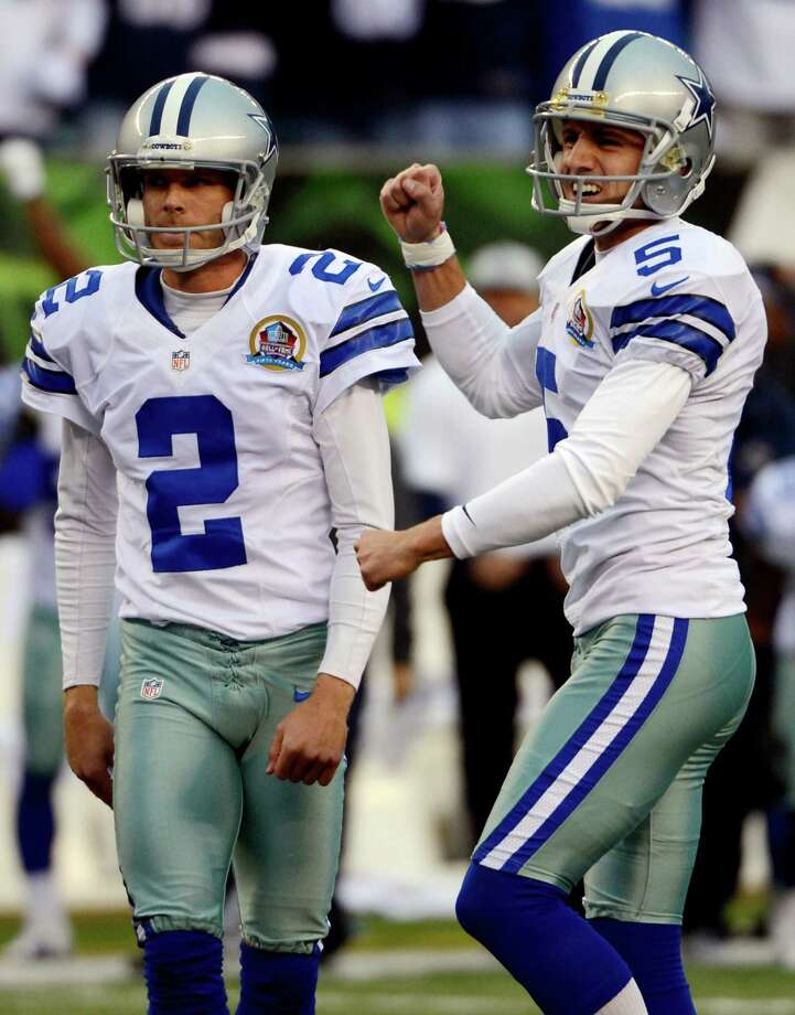 Dallas Cowboys kicker Dan Bailey (5) reacts after making a 40-yard field goal in the final seconds of the fourth quarter of their NFL football game to give them a 20-19 win over the Cincinnati Bengals, Sunday, Dec. 9, 2012, in Cincinnati. Holder Brian Moorman (2) watches. (AP Photo/Michael Keating) Photo: Michael Keating, Associated Press / FR170759 AP