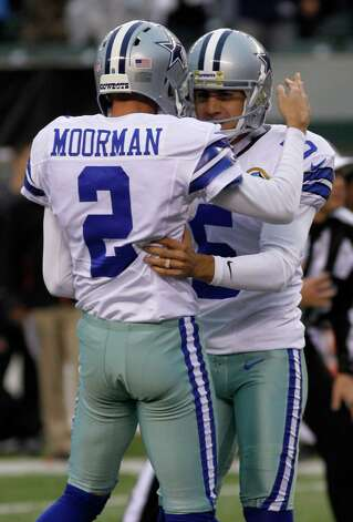 Dallas Cowboys kicker Dan Bailey (5) is congratulated by holder Brian Moorman (2) after Bailey kicked the game winning field goal against the Cincinnati Bengals in an NFL football game, Sunday, Dec. 9, 2012, in Cincinnati. (AP Photo/Tom Uhlman) Photo: Tom Uhlman, Associated Press / FR31154 AP