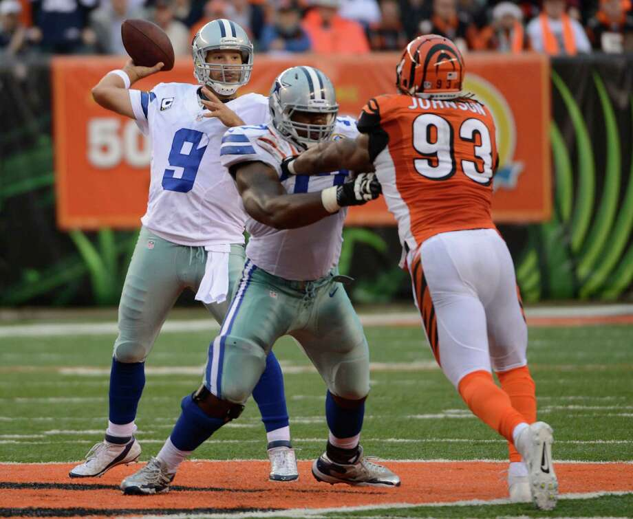 Dallas Cowboys quarterback Tony Romo (9) passes against the Cincinnati Bengals in the second half of an NFL football game, Sunday, Dec. 9, 2012, in Cincinnati. (AP Photo/Michael Keating) Photo: Michael Keating, Associated Press / FR170759 AP