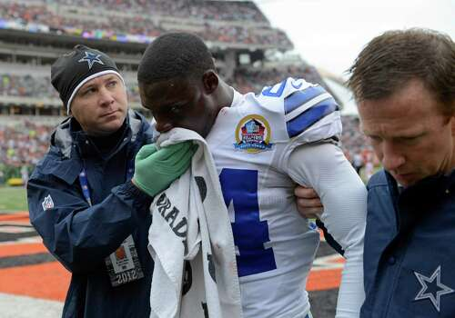 Dallas Cowboys cornerback Morris Claiborne (24) is helped off the field after he was injured in an NFL football game against the Cincinnati Bengals, Sunday, Dec. 9, 2012, in Cincinnati. (AP Photo/Michael Keating) Photo: Michael Keating, Associated Press / FR170759 AP