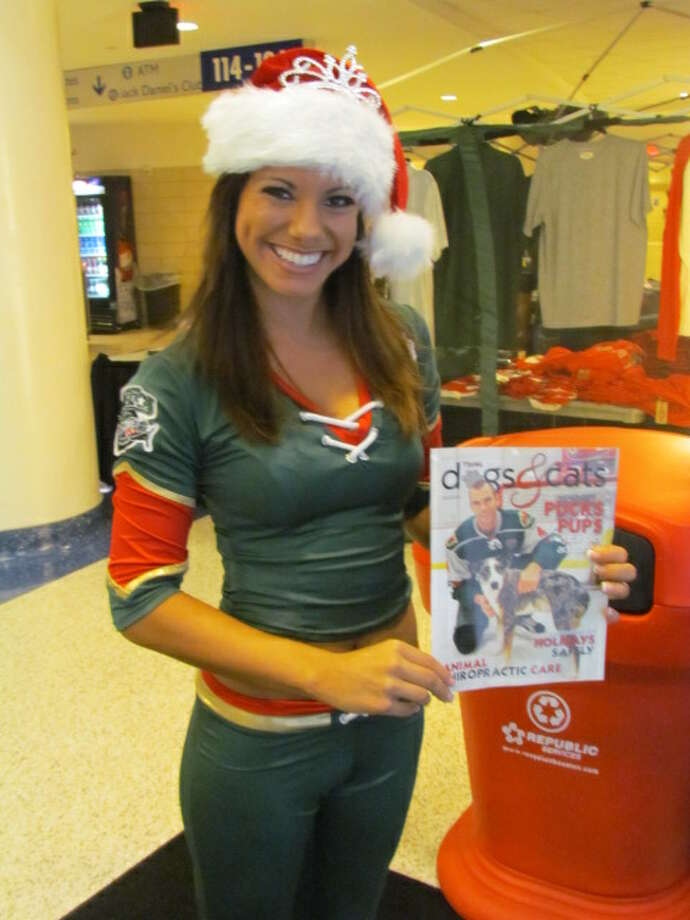 Aeros dancer Laurel shows off Aeros captain Drew Bagnall on the cover of Texas dogs & cats magazine. (Mike Damante)