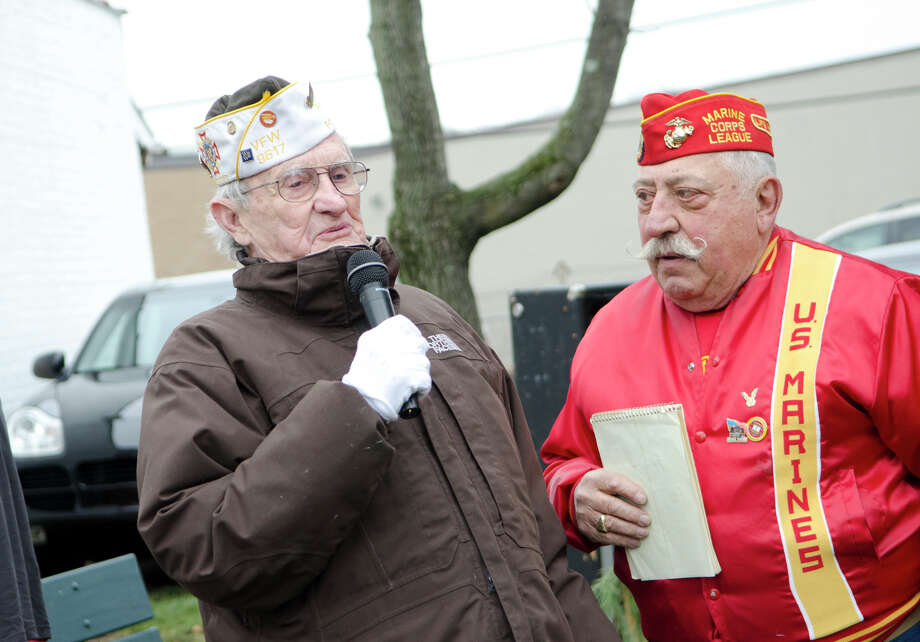 World War II veteran Jimmy Nestor says a few words alongside U.S. Marine Corps League of Stamford Commandant Pat Battinelli during the Pearl Harbor Remembered at the Springdale monument on Hope Street in Stamford on Sunday, Dec. 9, 2012. Photo: Amy Mortensen / Connecticut Post Freelance