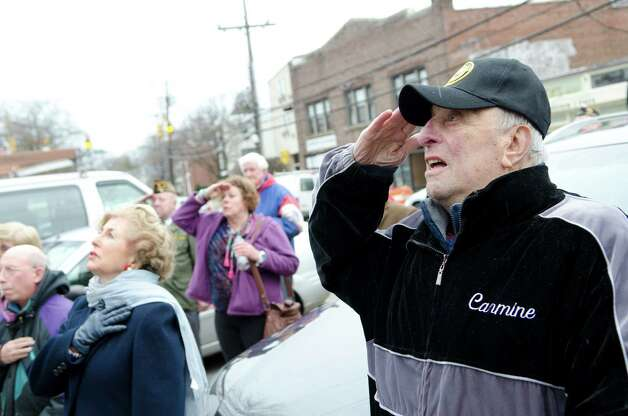 Navy veteran Carmine Vaccaro, of Stamford, salutes during the Pearl Harbor Remembered at the Springdale monument on Hope Street in Stamford on Sunday, Dec. 9, 2012. Vaccaro, who served as a U.S. Navy Hospital Corpsman during the Korean War, was inducted in the Connecticut Veterans Hall of Fame in Hartford on November 28, 2012. Photo: Amy Mortensen / Connecticut Post Freelance