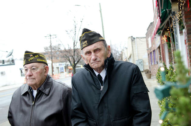 National Guard veteran Frank DeMasi, who served during the Korean War, and Army veteran Edward Lucas, who served in North Africa and Europe from 1943-1946, listen to a proclaimation as it is read during the Pearl Harbor Remembered at the Springdale monument on Hope Street in Stamford on Sunday, Dec. 9, 2012. Photo: Amy Mortensen / Connecticut Post Freelance