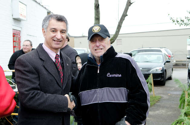 Connecticut State Senator Carlo Leone stands with Navy veteran Carmine Vaccaro during the Pearl Harbor Remembered at the Springdale monument on Hope Street in Stamford on Sunday, Dec. 9, 2012. Vaccaro, who served as a US Navy Hospital Corpsman during the Korean War, was inducted in the Connecticut Veterans Hall of Fame in Hartford on November 28, 2012. Photo: Amy Mortensen / Connecticut Post Freelance
