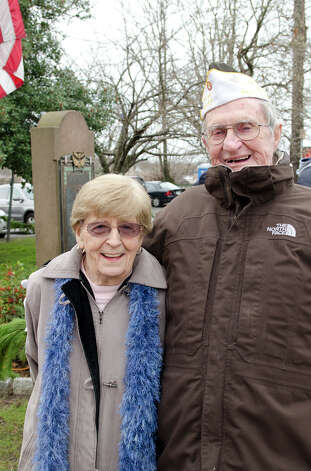 World War II veteran Jimmy Nestor and his wife, Dot Nestor, of the Ladies Auxilary Post 9617, pose for a photograph during the Pearl Harbor Remembered at the Springdale monument on Hope Street in Stamford on Sunday, Dec. 9, 2012. Photo: Amy Mortensen / Connecticut Post Freelance