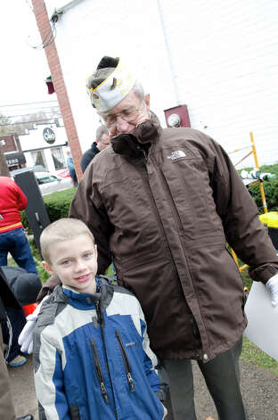 World War II veteran Jimmy Nestor stands with his grandson, Declan Nestor, 7, of Stamford, during the Pearl Harbor Remembered at the Springdale monument on Hope Street in Stamford on Sunday, Dec. 9, 2012. Photo: Amy Mortensen / Connecticut Post Freelance