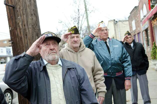 Veterans salute during the Pearl Harbor Remembered at the Springdale monument on Hope Street in Stamford on Sunday, Dec. 9, 2012. From left, Army veteran Dudley Jenkins, Army and Navy veteran George Sheridan, Army veteran Fred Drenckhahn, and Army veteran Edward Lucas. Photo: Amy Mortensen / Connecticut Post Freelance